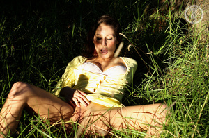 Steaming hot chick shows her juicy tits and indulging pussy in different poses wearing her yellow blouse and skirt in a garden. - XXXonXXX - Pic 5