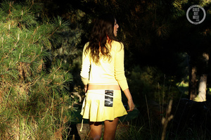 Steaming hot chick shows her juicy tits and indulging pussy in different poses wearing her yellow blouse and skirt in a garden. - XXXonXXX - Pic 8
