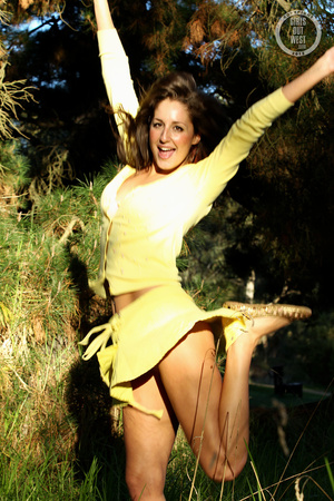 Steaming hot chick shows her juicy tits and indulging pussy in different poses wearing her yellow blouse and skirt in a garden. - XXXonXXX - Pic 9