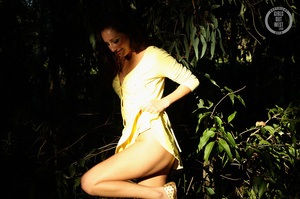 Steaming hot chick shows her juicy tits and indulging pussy in different poses wearing her yellow blouse and skirt in a garden. - XXXonXXX - Pic 11