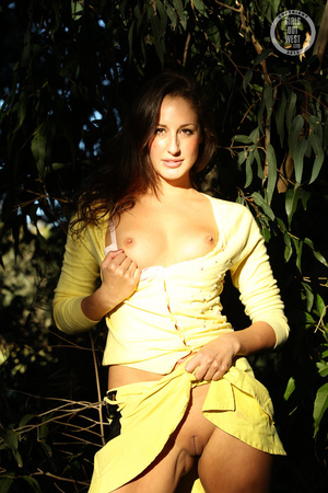 Steaming hot chick shows her juicy tits and indulging pussy in different poses wearing her yellow blouse and skirt in a garden. - XXXonXXX - Pic 13