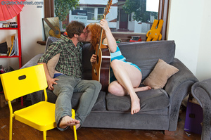 Indulging babe with foxy body in blue striped shirt and jeans shorts makes out with her stud boyfriend while holding a guitar then sucks his dick before she gets naked and lets him lick her hairy crack on a gray couch then fuck her in multiple styles on a yellow chair. - XXXonXXX - Pic 1