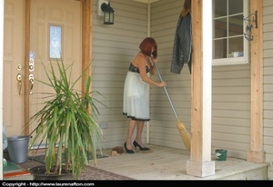 Redhead MILF cleaning her porch, stripping and peeing - XXXonXXX - Pic 1