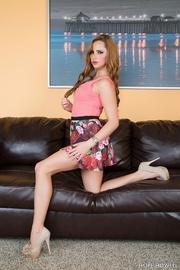 leggy brunette floral skirt