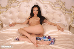 Luscious babe expose her sweet pussy before she removes her multi colored dress and bares her small tits and skinny body in different poses on a pearl white bed. - XXXonXXX - Pic 15