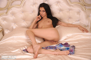 Luscious babe expose her sweet pussy before she removes her multi colored dress and bares her small tits and skinny body in different poses on a pearl white bed. - XXXonXXX - Pic 16