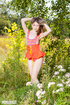 Cute babe teases with her skinny body in pink and orange leotard and orange