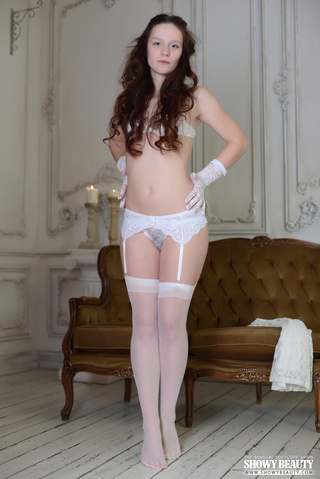 alluring babe strips white