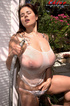 Brunette gets her white t-shirt wet and completely see-through