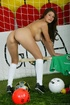 Brunette soccer fan in a green jersey gets naked on cam