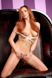 luscious redhead teases with