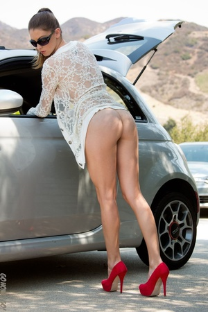 Alluring babe in sunglasses bends over her car for a naked pictorial. - XXXonXXX - Pic 7