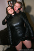 Chubby brunette in leather dress and boots gets her booty whipped by short