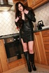 Brunette in leather outfit and fur teasing in the kitchen before fingering