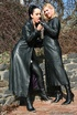 Two sexy cunts in leather coats and boots undressing outdoors and enjoying