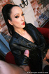 Red lipped stunner in leather outfit and high boots teasing her shaved
