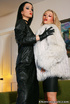 High heeled blonde in white fur jacket and her black haired mate in leather