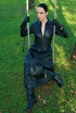 Black haired mistress in leather coat and black boots flashing her yummy