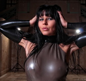 Grey latex get-up brunette with bangs posing half-naked outdoors at night
