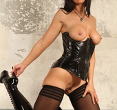 Stockings and tall latex boots brunette shows off her big tits and smooth
