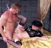 Collared blonde in latex top and black stockings gets her shaved pussy
