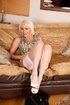 Blonde MILF in white stockings gets naked on camera