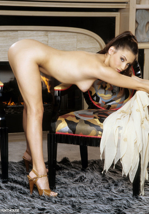Stunning babe peels off her brown dress and bares her foxy body with luscious tits and indulging pussy in different poses on a gray and white carpet wearing her brown high heels. - XXXonXXX - Pic 9