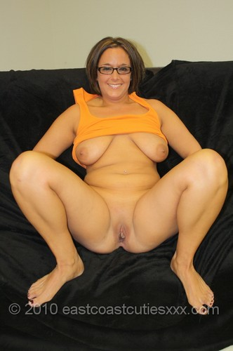 Very Hot Milf In A Yellow Vest And Glasses Gets Naked To -3832