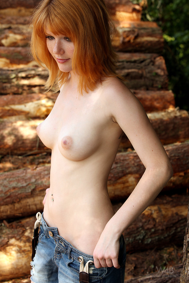Naked redhead girl in the woods