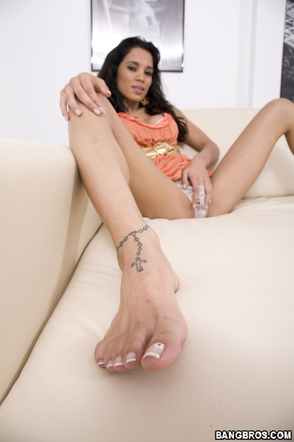 Footjob for cock in orange condom and 2 cock rings 9