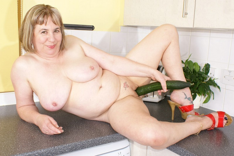 image Milfs play with veggies in kitchen