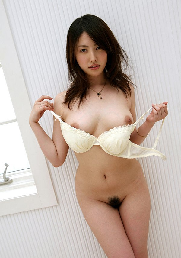 Nymph takes off her white bra and poses naked on a chair and floor.. Takako  Kitahara. Picture 2.