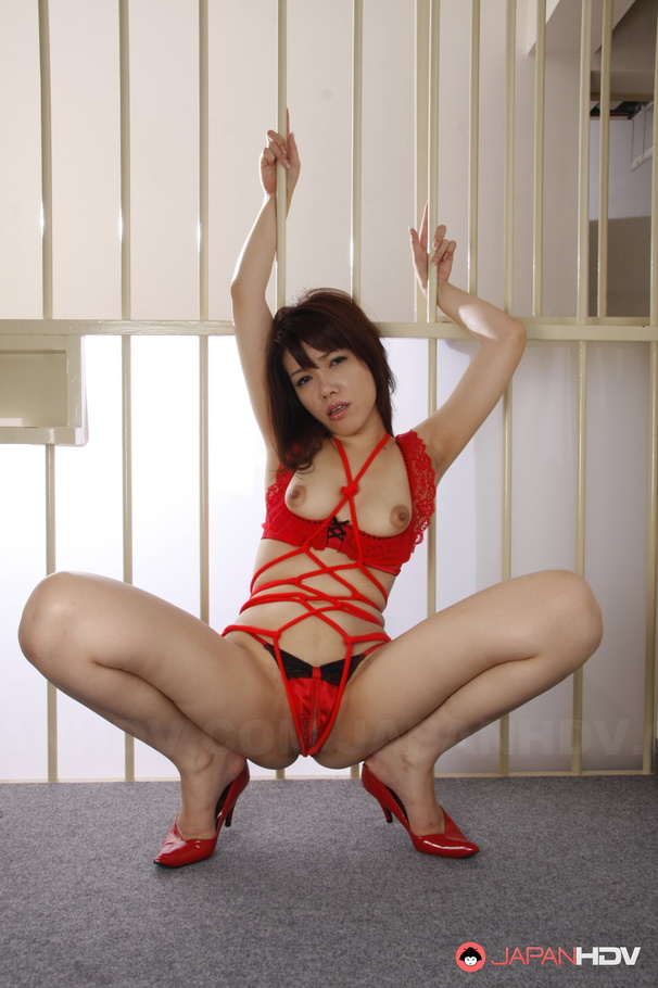 Asian girl in ropes posing but never