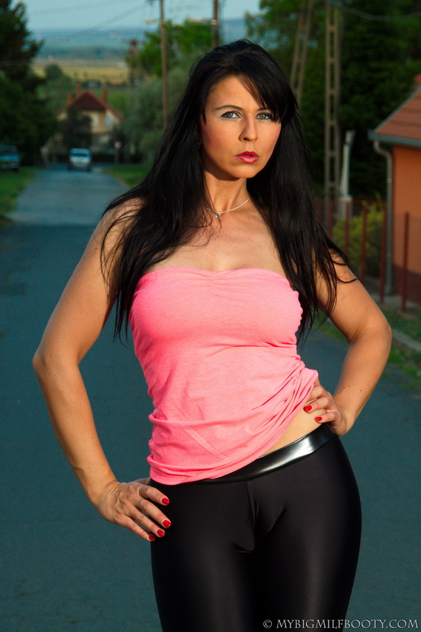 Small Town Brunette Stunner Poses On Deserted Street In A Pink Top And Black Pants -6056
