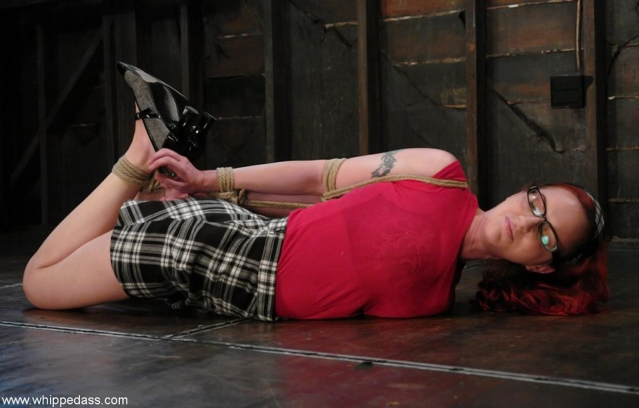 Tied up busty redhead throat and cunt banged