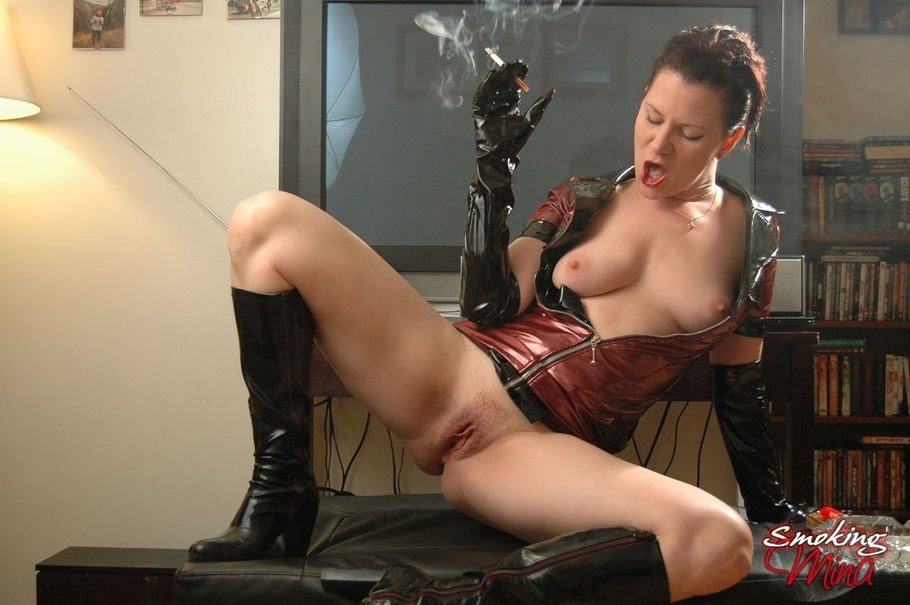 Hot Seductress In A Red And Black Leather Jacket Smokes A ...