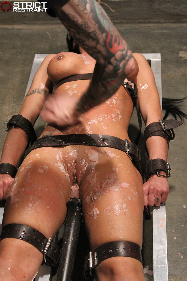 steaming hot chick gets tied strapped and cuffed naked in