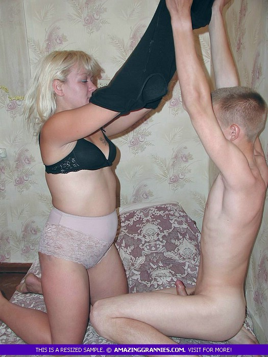Fat blonde granny strips off her black dress and bra and teases a skinny  young dude ...