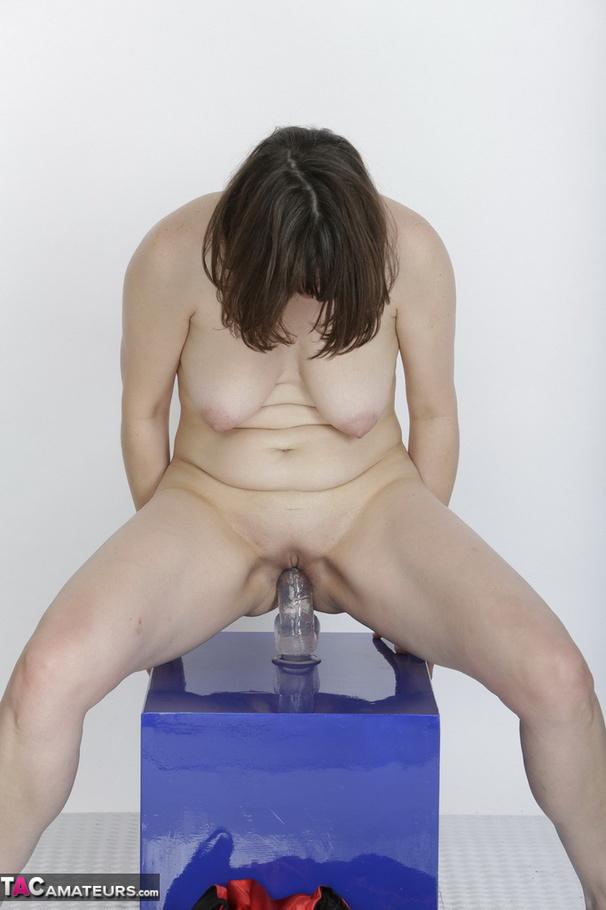 Slutty amateur brunette milf using a dildo