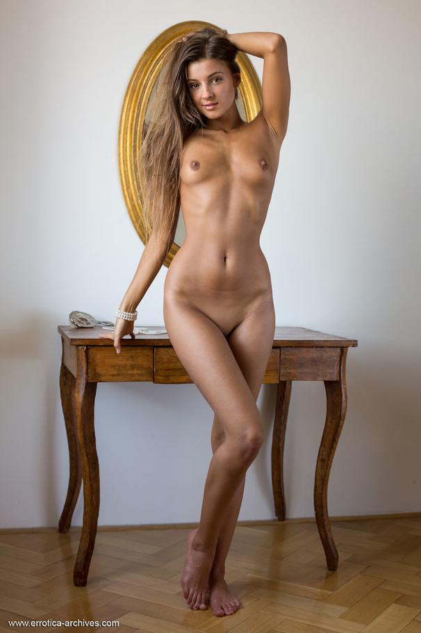 Redhead nude in car