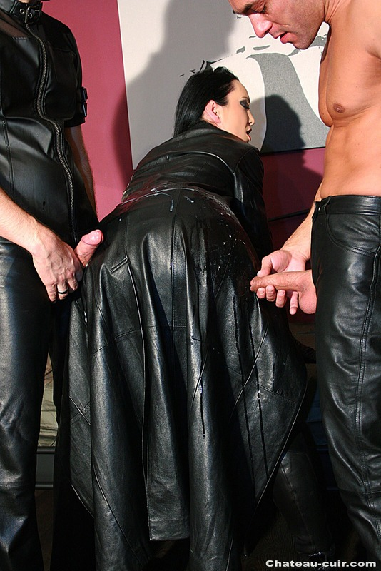Black haired lass in leather coat and corset gets cum covered after sucking two guys on her knees and dick riding