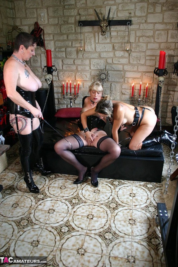 Blonde shemale and two collared chicks in leather boots using strapon  during threesome banging on the