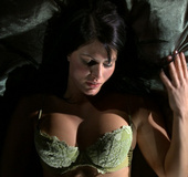 Dark haired Hungarian babe Karmen waits for you in her bed.