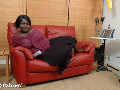 Plump ebony housewife revealing her epic melons on the - Picture 2
