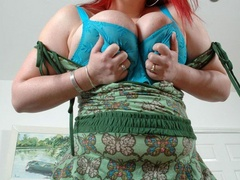 BBW redhead stunner with heavy melons stripteasing on a - Picture 3