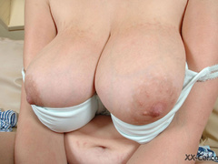Big boobied smily chick slowly taking off her clothes - Picture 6