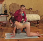 Submissive slave brunette suffers a hot wax on her back while totally