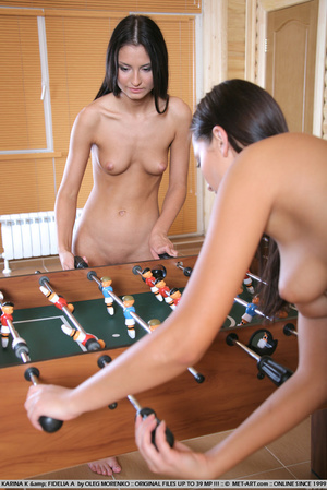 Foosball with naked dark haired girls wh - Picture 1