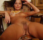 Exotic Hanna reveals her firm breasts and natural labia in this indoor