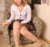 Blonde teen stripping off and spreading her legs wide open